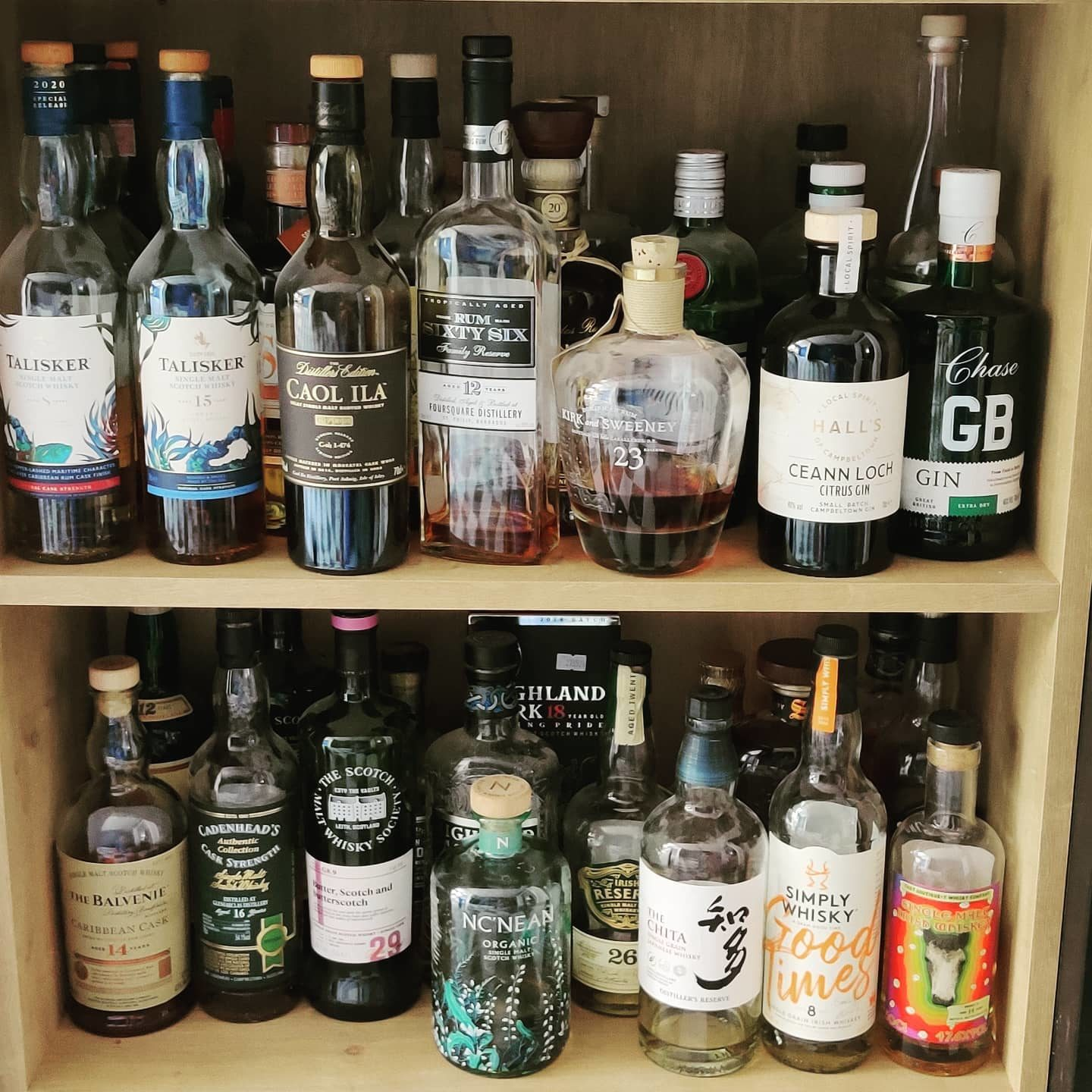 """That's the spring-cleaning done then – """"working"""" shelf in the kitchen sorted! Smokey top-left, rum in the middle, gin on the right, and the #shelfofhighballhappiness below."""